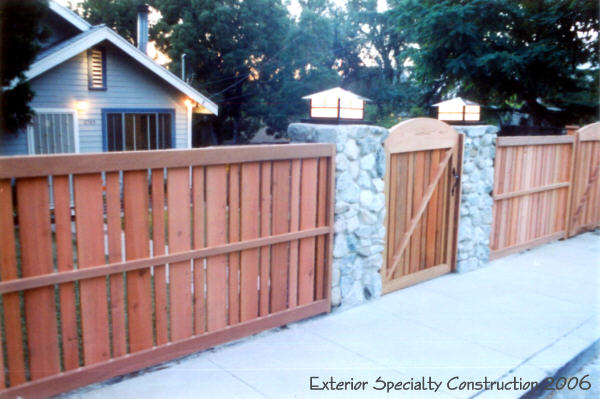 Redwood fence and River Rock Pilasters