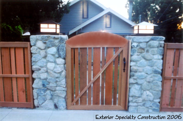 Redwood Gate and River Rock Pilasters